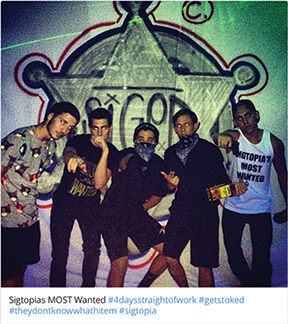 "A group of students poses at a themed party using the hashtag #Sigtopia. Instagram photo from ""over 1 year ago."""