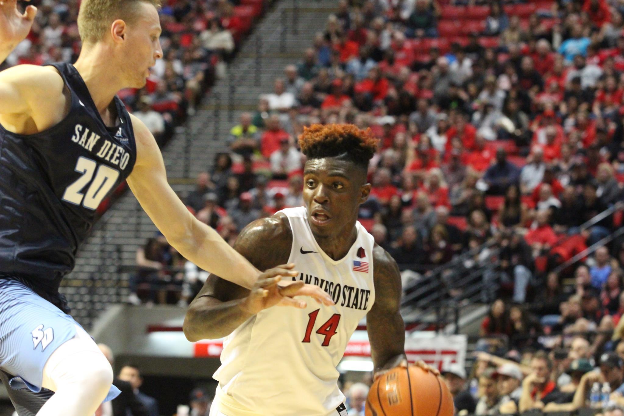Redshirt sophomore forward Zylan Cheatham attacks the basket against University of San Diego.