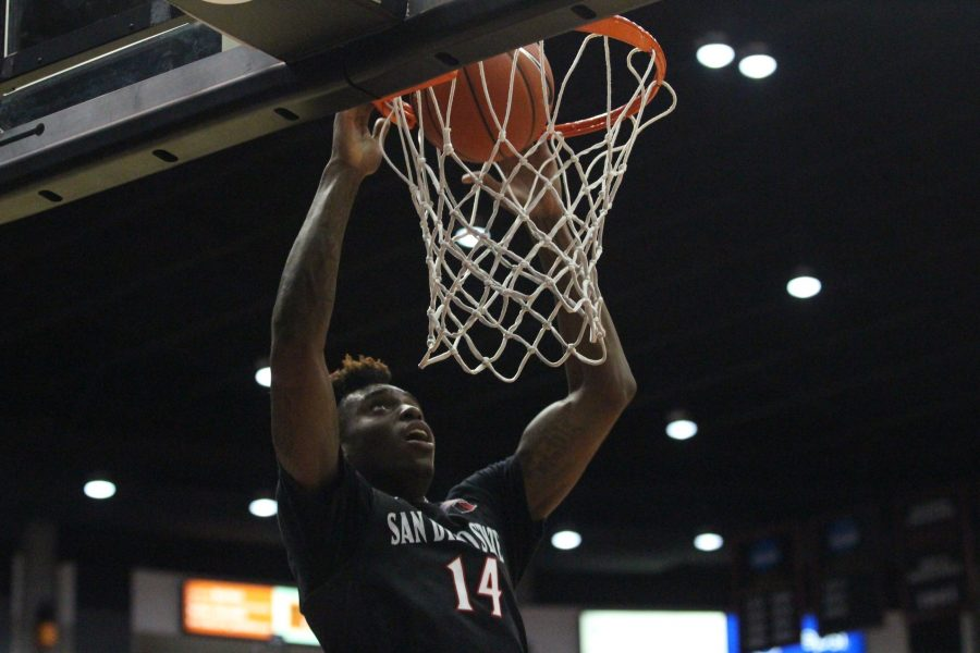 Redshirt+sophomore+forward+Zylan+Cheatham+finishes+a+dunk+in+the+Aztecs%27+46-28+win+over+San+Diego+Christian.